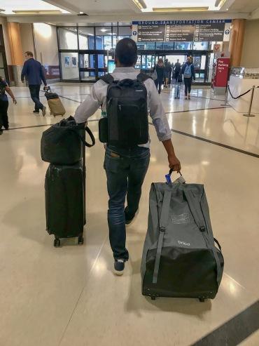 Carlyle wheeling the Cover Guard Car Seat Travel Tote through the Hartsfield-Jackson Atlanta International Airport